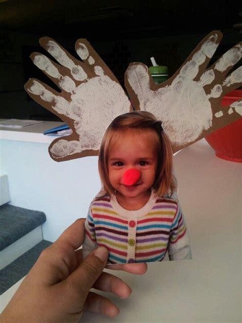 reindeer craft to sell reindeer craft use beige paint on brown paper to make handprints cut out to make antlers add