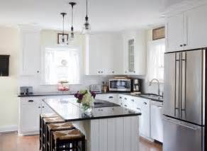 white l shaped kitchen with island white kitchen cabinets with black countertops