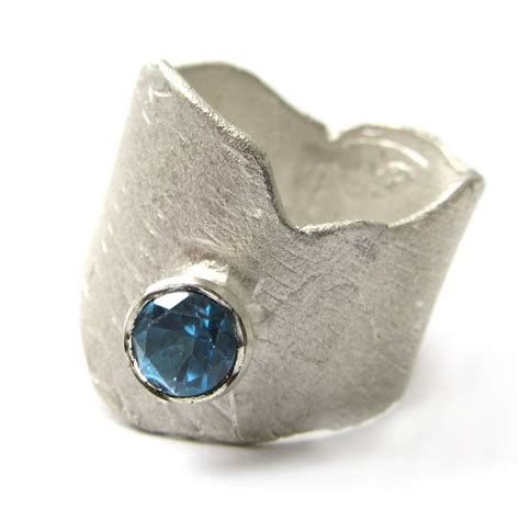 sculptural sterling silver ring with blue topaz