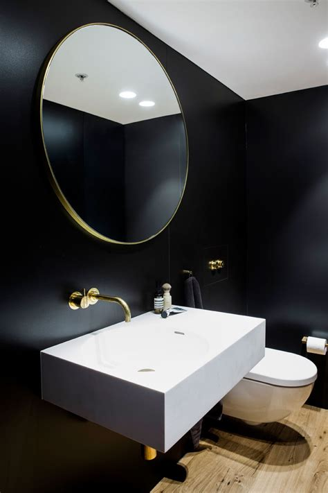 black white gold bathroom this apartment is filled with a palette of black and gold