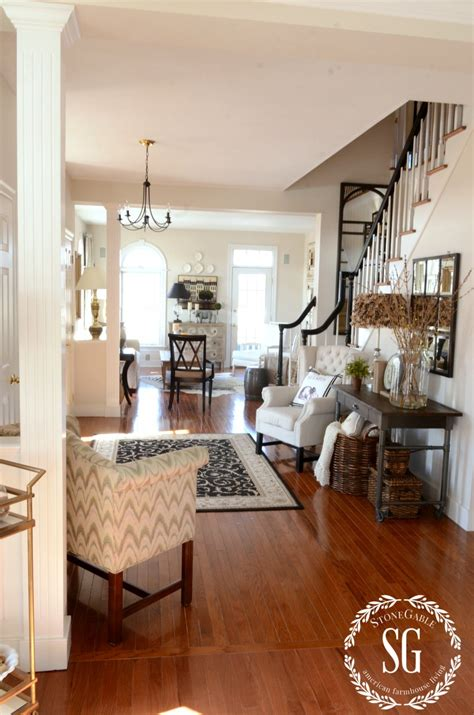 hanging decorations for living room adding an upholstered chair to the foyer breaking the