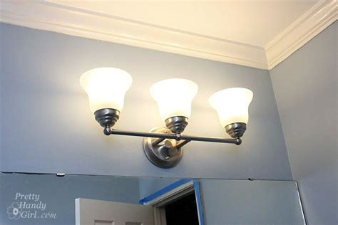 changing light fixture in bathroom changing out a light fixture bye bye hollywood strip