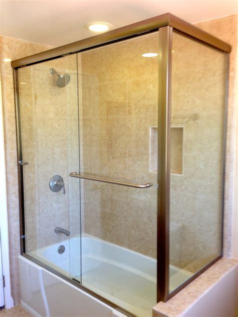 bathtub with glass enclosure long glass door with silver steel handler combined with