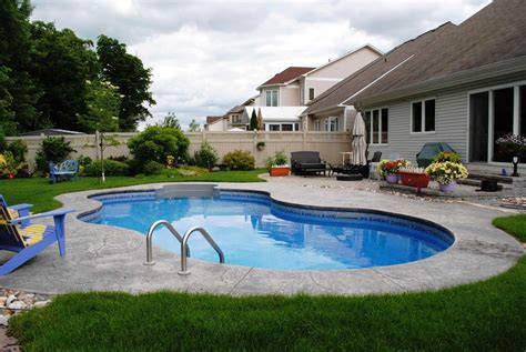 pool in backyard cost backyard pool building and maintenance costs