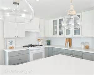Jeff Lewis Kitchen Designs gray lacquered kitchen cabinets with white and silver oval