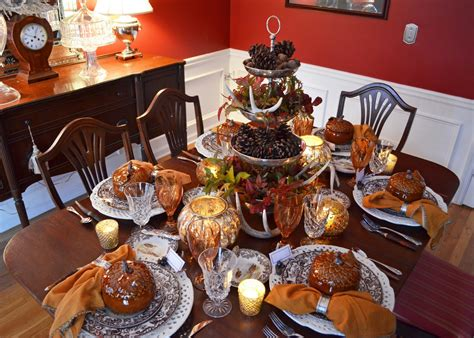 setting a table for thanksgiving thanksgiving table setting with nature themed centepiece