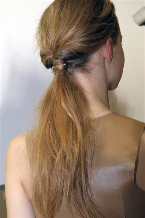 hairstyle using rubberbainds and folding hair through to create braid knotted ponytail 7 creative ways to wear a ponytail