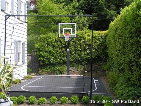 small basketball court in backyard small side yard basketball court w boxwood and net