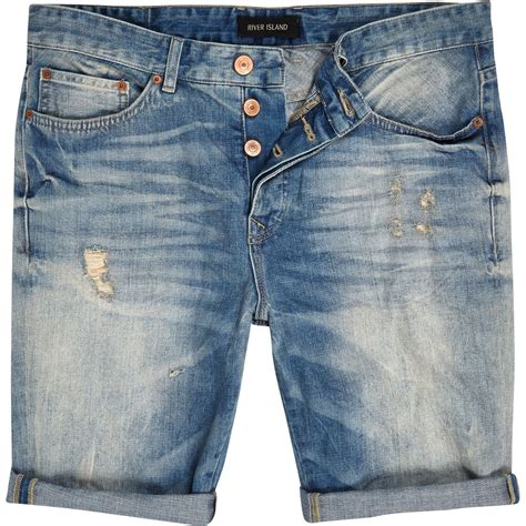 light wash distressed shorts lyst river island light wash distressed denim shorts in