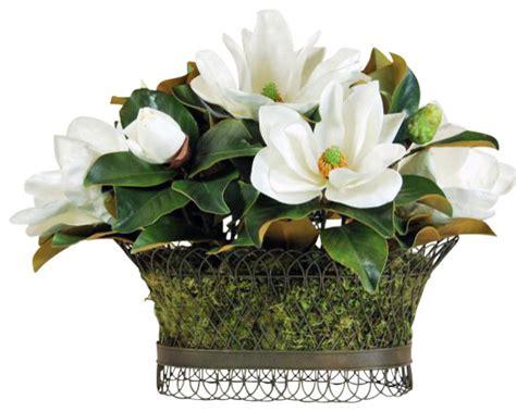 magnolia wire basket flower arrangement traditional