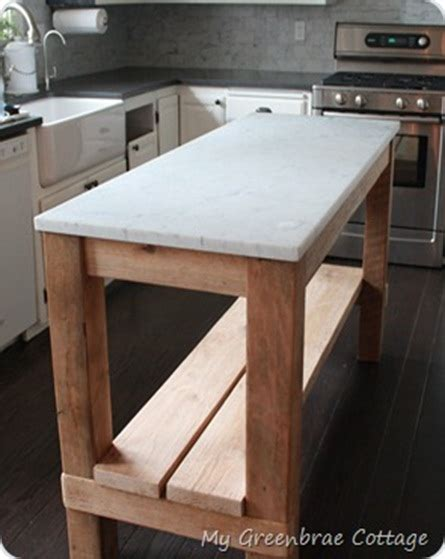 the salvaged wood kitchen island from restoration hardware forever interiors islands reclaimed