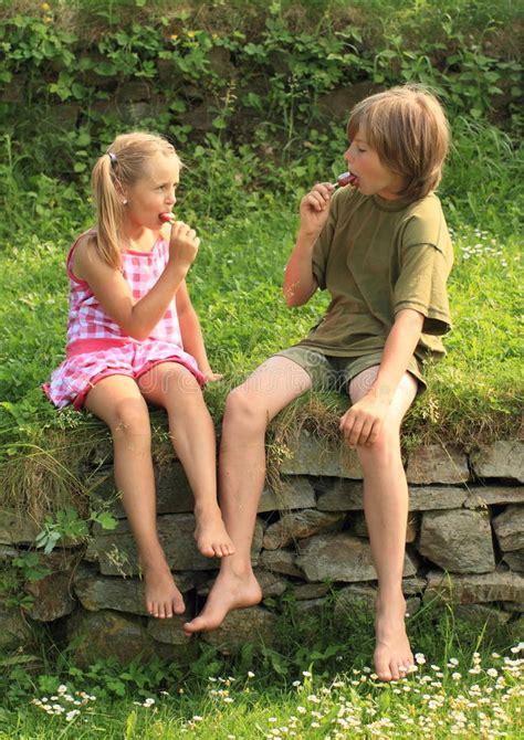 boys barefoot preteen kids eating ice cream stock photo image of hand icecream