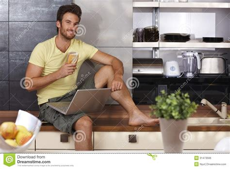 Guys Kitchen Handsome With Laptop In Kitchen Royalty Free Stock