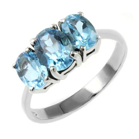 9ct white gold oval blue topaz 3 ring jewellery