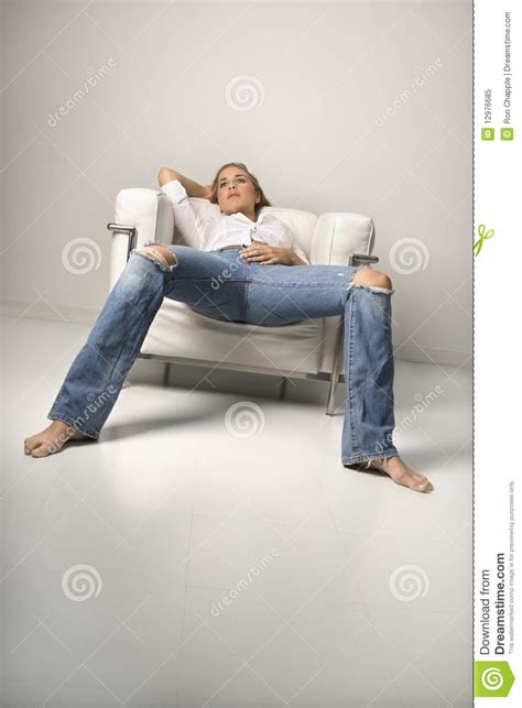 woman in armchair young woman relaxing in armchair royalty free stock photo