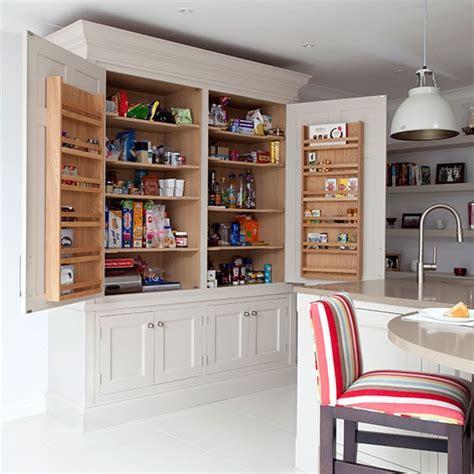 Pale grey kitchen with Shaker style larder cupboard
