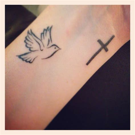 dove cross tattoos dove flying towards the cross tattoos