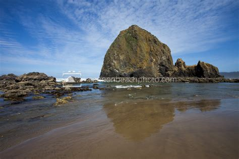haystack rock low tide morning light cannon beach photo