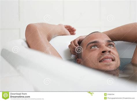 man in a bathtub man relaxing in bathtub stock photo image of imagination