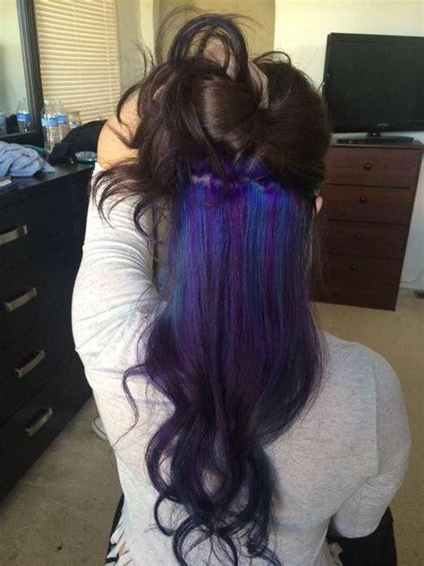 red underlay on hair pull off rainbow hair with these subtle rainbow highlights