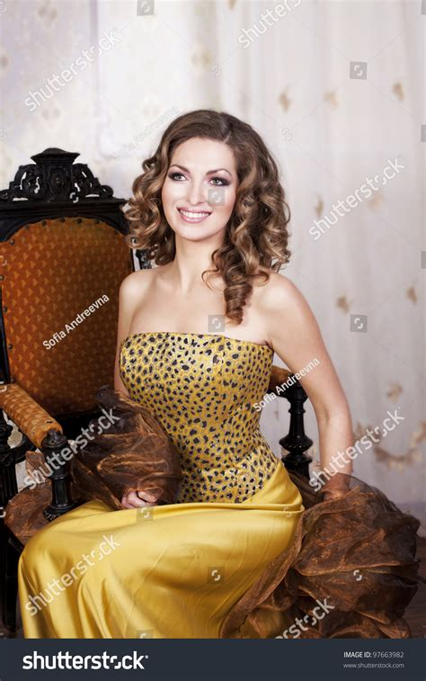 beautiful rich beautiful rich golden dress stock photo