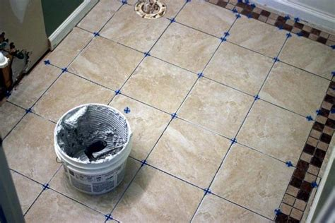 installing floor tiles in bathroom how to install bathroom floor tile how tos diy