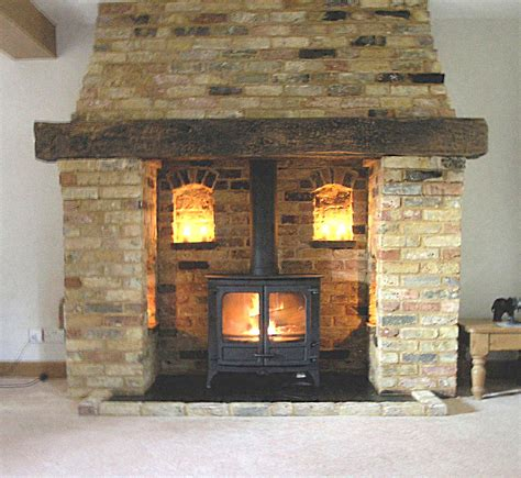 inglenook fireplace designs bespoke reclaimed brick and oak inglenook fireplace with a