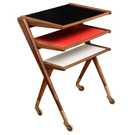 modernist rolling side table magazine rack at 1stdibs