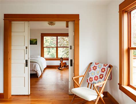 just embrace the orangish wood tone of the trim stain the floors to match install white doors