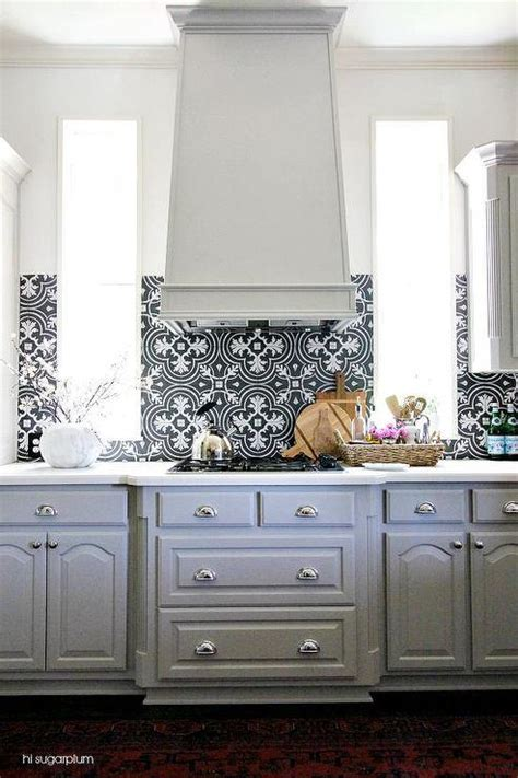 black and white backsplash gray kitchen cabinets with black and white backsplash
