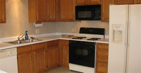 best way to stain kitchen cabinets best way to spruce up finish on medium oak kitchen