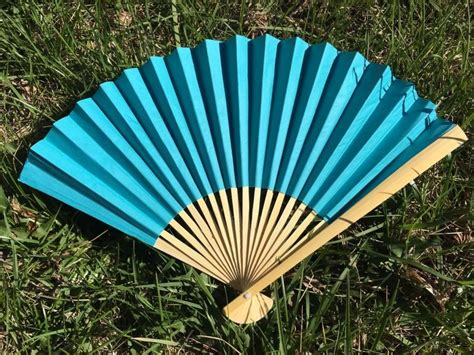 chinese fans for sale sale turquoise paper fan for wedding 9 quot hand fan