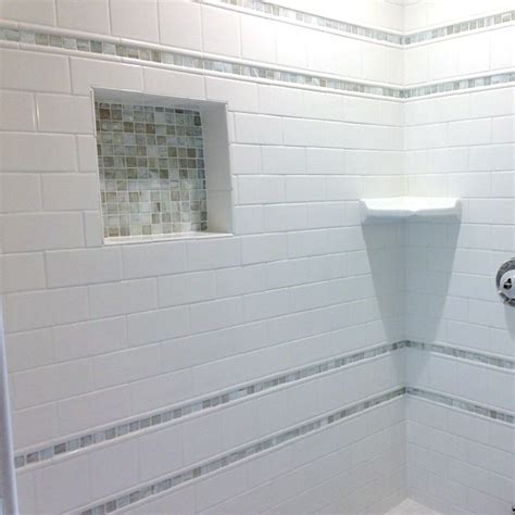 Walk In Showers For Small Bathrooms classic white subway tiles and glass mosaic accents