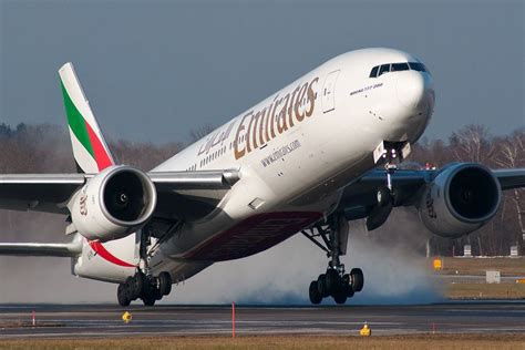 bid on flights emirates introduces free laptop and tablet handling