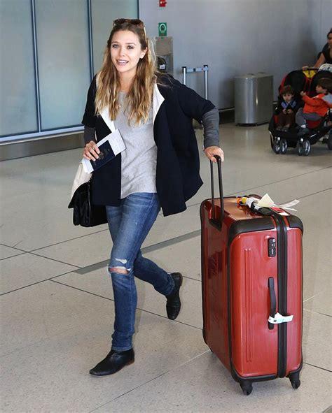 Elizabeth Bag Perry Suitcase Black elizabeth also arrived toronto looking comfy ripped