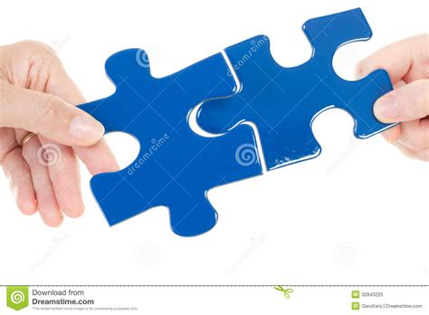 Put Together by Putting Two Pieces Of Jigsaw Together Royalty Free Stock