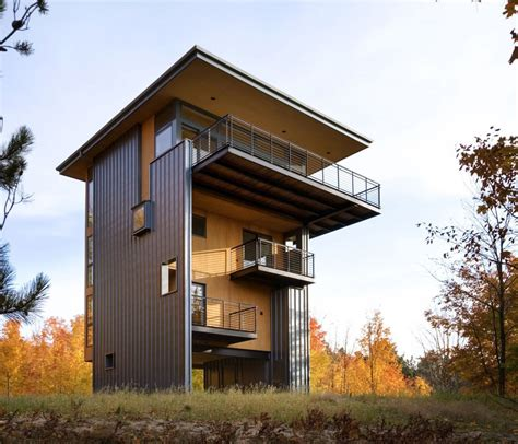 4 storey house reaches above the forest to see the lake