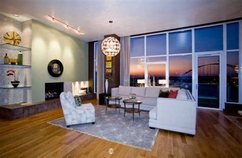 Track Lighting Illuminates A Fireplace In A Modern Living | 34 modern fireplace designs with glass for the