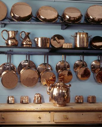 Kitchen Shelves For Pots And Pans by The Copper Pots And Pans On The Shelves In The Kitchen At