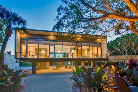 tour an elevated modern glass house in osprey florida