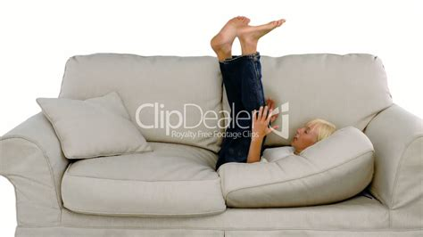 jumping on the sofa young boy jumping on the sofa on white background royalty
