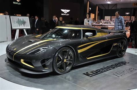 gold koenigsegg koenigsegg hundra arrives at geneva motor show wrapped in