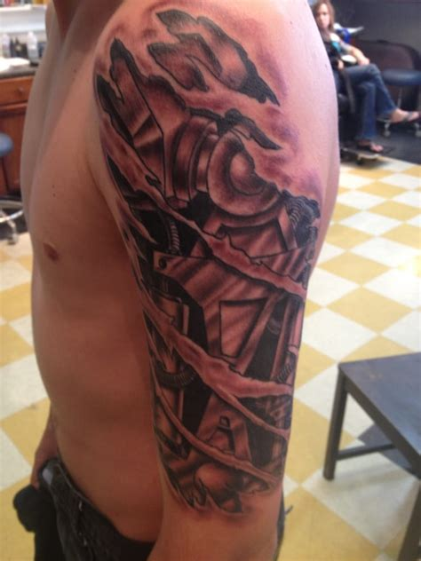 robo arm tattoo by chris arredondo absolute tattoo yelp