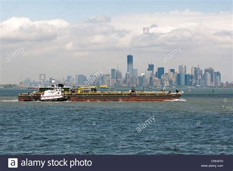 Tug Boat Shoppinf tug boat taurus dbl 23 barge crossing new york harbor with a stock photo royalty free image
