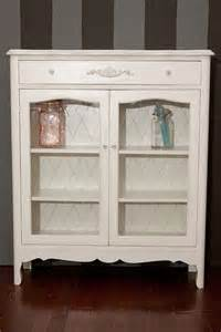 small cabinet with glass doors sold ivory white
