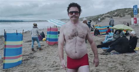 southern comfort beach video harry enfield strips off for charity spoof of