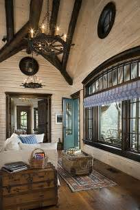 flat interior log walls with white washed finish and stained structural log rafters notice