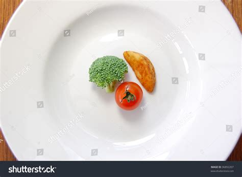 small food small portion of food on a big plate stock photo 36892207