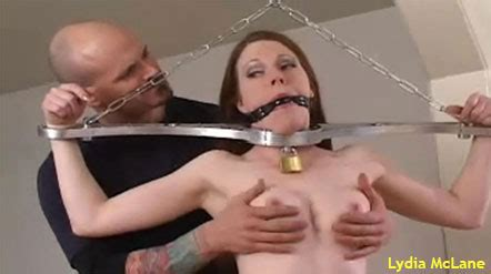 See Pix And Videos Of Lydiamclane Gagged And Groped In A Rigid Cuff Video By Houseofgord