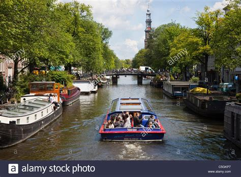sailing boat on canal amsterdam canal boat stock photos amsterdam canal boat
